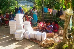 Women enagaged in livelihood by crafting straw bags with mould